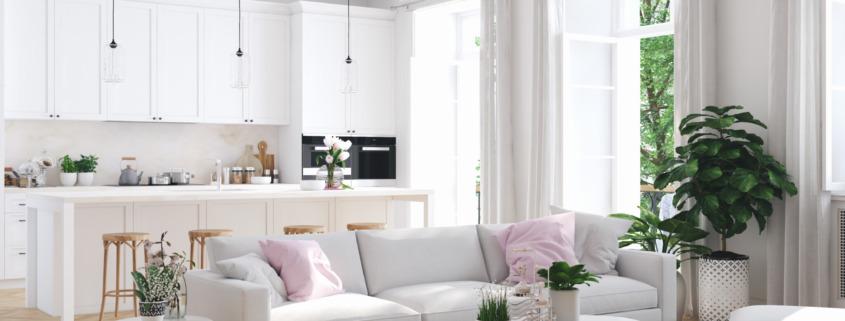 Open space cucina e soggiorno separato da una penisola e dal divano